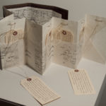 """'Invisisble'(pocket accordion book) edition of 5 Handmade abaca paper, Xerox transfer of free images, shipping labels, pins, pencil thread and colored board. 6x10x5"""" open"""