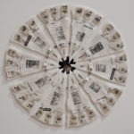 """'Mandala for the Perpetual Dieter' Handmade abaca paper, Xerox transfer of free images, shipping labels, pins, pencil and thread. 21"""" diameter"""