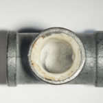 Winifred_McNeill_IndustrialStrength_Graphite on Plaster in Pipe_2x3x2in