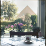 Dorie_Dahlberg_Tradition- Visiting Aunt May Who Is 95 For Fika in a Tea Cup in Sweden _Analogue Photography_12X12