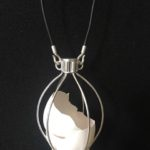 Judy_Wukitsch_Manifest, Our State of Being- Protecting_sterling silver, mixed media_4.5_x3.5_ caged piece
